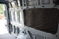 The stock interior of a Sprinter Crew van isn't anything special. Lots of exposed metal, no insulation, and no storage space. We stripped out all the stock plastic wall panels and headliner, …