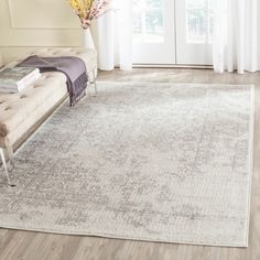 Featuring a stylish overdyed aesthetic, this 5'1 x 7'6 rug from Safavieh's Adirondack Collection makes a striking fashion statement in any room. Its ivory and silver color combination provides the per