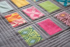 Quilted | by Little Bluebell. Loving the grey dashing and simple quilting.