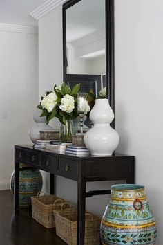 Great hallway table display, keep it simple with books and vases of flowers