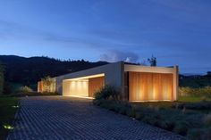 concrete, textured stucco w/teak wood cladding that softens the surfaces
