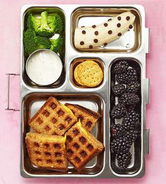 Any kid will look forward to feasting on a waffle grilled cheese, broccoli with dip, banana with mini chocolate chips, crackers, and blackberries.