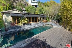 Relaxing: The home boasts a swimming pool and deck/lounging area in the backyard