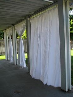 Outdoor Curtains. This would be cool for a ceremony/reception space out in a field or something. Put up some posts and connect lines of fabric between them (or maybe ribbon-curtains). A girl can dream.