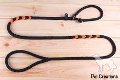 Jachtlijn met dubbele stop in zwart & oranje.    #jachtlijn #sliplijn #hondenlijn #hondenriem #multilijn #ppmtouw #petcreations