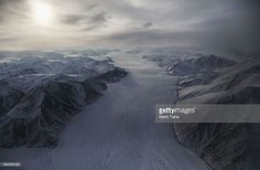 A section of a glacier is seen from NASA's Operation IceBridge research aircraft on March 29, 2017 above Ellesmere Island, Canada. The ice fields of Ellesmere Island are retreating due to warming temperatures. NASA's Operation IceBridge has been studying how polar ice has evolved over the past nine years and is currently flying a set of eight-hour research flights over ice sheets and the Arctic Ocean to monitor Arctic ice loss aboard a retrofitted 1966 Lockheed P-3 aircraft. According to…