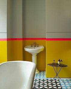 Heaven or hell? - bold yellow topped with a neon pink dado rail. This is a bathroom in Manish Arora's Parisian home.