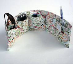 cute purse organizer, another reason I need a sewing machine. Her price is reasonable too.