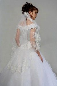 pretty lace-edged veil and off the shoulder gown
