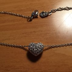 ❤️ Swarovski Necklace with Heart Pendant ❤️ ⚡️Reduced⚡️Swarovski necklace with double sided heart pendant never been worn! Comes with box and certificate. As seen in the last picture, I somehow lost the bottom velvet piece to the box. Absolutely stunning and beautiful. The pictures do not do it justice!! If I didn't already have a necklace I love and wear everyday, this would be it. No trades please! Swarovski Jewelry Necklaces