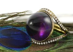 Amethyst is said to ward off drunkenness, and protect from poison. Wear this amethyst and diamond ring, and see what other magical powers appear...!