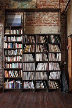 In my dream home there is a room for my favorite music and books, AND it has exposed brick walls.