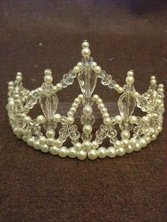 Crystal crown are very popular in weddings! Every woman wants to be a princes for at least one day! This wire wrapped crown is very elegant, not overwhelming and brings the royal look in every lady!   This tiara measures 3.5 inches at its highest peak and was created using Czech crystals and glass pearls.  There is a hole at the end of both side for easy positioning by using bobby pins.  This Tiara available for other colors, please contact me if you want another color.