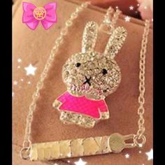 Pink and gold little girl bunny.  2 available. Black piercing eye accentuates this beautiful pink and gold little girl bunny falling gracefully from a gold chain. The bunnies are made of a special Crystal to enhance their beauty. Jewelry Necklaces