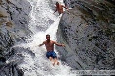Las Paylas (Las Chorreras in Spanish) are a natural water slide in El Yunque in Luquillo. This link gives instructions. Access is free!