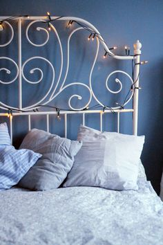 Bedroom fairy lights around a white metal bedstead