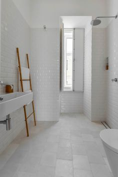 White subway tile creates a classic yet modern aesthetic in these kitchens and bathrooms.