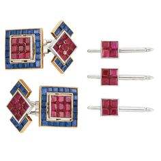 Platinum, Gold, Ruby, Sapphire and Red Enamel Dress Set, Cartier, Paris  18 kt., including a pair of cufflinks and three studs, centering 48 square-cut rubies approximately 8.75 cts., accented by red enamel balls, the cufflinks edged by 56 square and rectangular-cut sapphires approximately 6.45 cts., cufflinks signed Cartier,