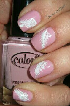 Pink nails with white feather