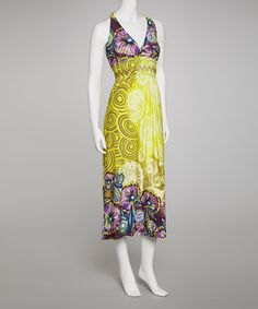 Bold and bright, this maxi adds excitement to any occasion's ensemble. The shirred waist and fitted v-neck bodice draw the eye up, narrowing the frame, while the swirl and floral pattern, with an accent rosette corsage, give this frock a romantic flair. Size note: This item runs small. Please refer to the size chart.