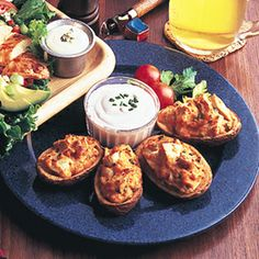 Buffalo chicken stuffed potatoes... might need to try this