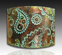 Love the contrast of fresh and lively paisley with earthy colors! Adriana Allen original polymer clay jewelry