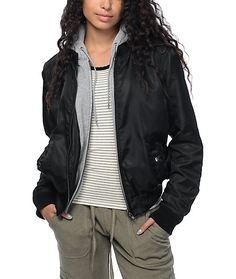 For the perfect layered look with less bulk, this Mika black fleece hooded bomber jacket from Trillium will be your all around jacket for any season. The fleece lining goes throughout the arms so even wearing it with just a t-shirt is even cozy. Or for a