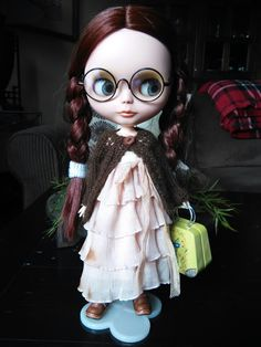 Such a cutie! Custom Blythe doll wearing glasses....cute outfit too!!