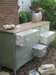 Love the surprise of stencils on the inside drawers! Would be so cute with pink or blue for a babys room!