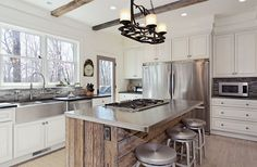 Stainless steel surfaces in a rustic style kitchen