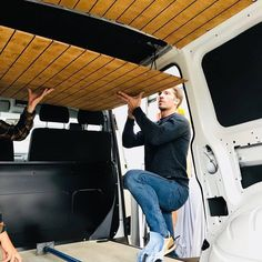 The boys while installing our wooden ceiling: Even though it looks like a lot of single slats, it actually comes in two big pieces that can easily be installed with some helping hands. #bullifaktur #buildyourpersonalcamper #diy #wood #vanconversion #vanlife #vanlove #van #camper #campervan #camperconversion #hamburg