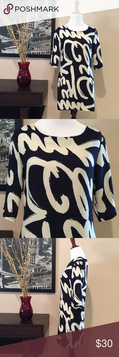 Graphic Print Navy & Cream 3/4 Sleeve Tunic Graphic Print Navy & Cream 3/4 Sleeve Tunic. Super cute and fun. Can be worn as a dress if you're short but the dress itself is short so I recommend wearing as a top or tunic. Navy blue with cream colored print. Unlined. Size and material are not marked but fits like a size small or XS. There is some give to the fabric but it is not stretchy. Feels like a cottony woven material. Boutique  Tops Tunics