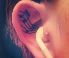3. Ear - I've heard people say that getting an ear tattoo doesn't really hurt because it gives off a tickling sensation, which makes it a lot more encouraging to choose it as a perfect place for a tattoo. Ear tattoos look very delicate and dainty due to their small nature, which makes them perfect for those who want small statement tattoos.