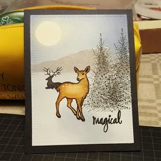 Deer and sentiment from Hero Arts, trees from Penny black on distress ink background