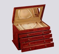 Maple Burl Four Drawer Jewelry Box. h1Maple Burl Four Drawer Jewelry Box_h1STRONGMaple Burl Jewelry Box. _STRONGandnbspCreated with precision and crafted to perfection.andnbsp This impressive jewelry box features four pull-out drawers for neat storage of .. . See More Jewelry Boxes at http://www.ourgreatshop.com/Jewelry-Boxes-C1090.aspx