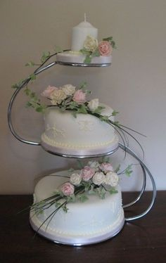 Two tier wedding cake displayed on 'S' shaped wedding cake stand with candle topper Vintage Wedding Cake Table, Wedding Cake Display, 3 Tier Wedding Cakes, Small Wedding Cakes, Wedding Cake Stands, Wedding Cake Decorations, Elegant Wedding Cakes, Wedding Topper, Wedding Desserts