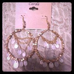 New. Never worn gold and white/opal earrings. New.  Gold and white earrings. Carole Jewelry Earrings