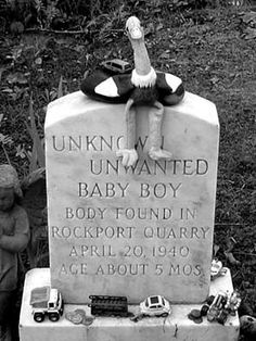 A baby's body was pulled out of a quarry years ago. The people of Rockport Maine collected money to give the boy a decent burial. People leave toys on the headstone.