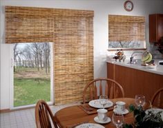 bamboo shades over patio doors.  Great alternative to shears over the windows.  Adds more privacy since our doors face the street.