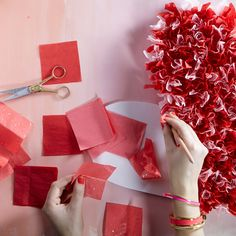"Show your friends you heart them with this festive wreath. Cut foam core into a 1' tall heart. Then cut red, pink and white tissue paper into 2"" squares. Using a hot glue gun affix the tissue paper to the heart until the foam core is completely covered."