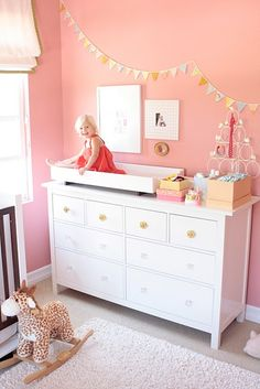 Im not a fan of an all pink room but EVERYTHING about this room i love! even the little girl is ADORABLE!