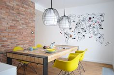 D47 by WIDAWSCY STUDIO ARCHITEKTURY. Wood + yellow + white ... Dining room... great idea for travel diary with pictures... map on the wall O.o