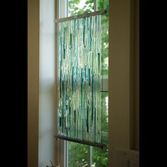"Textured fused Glass Sculpture with Aluminum frame and Stainless Steel cables 15"""" x 10"" x .50"""
