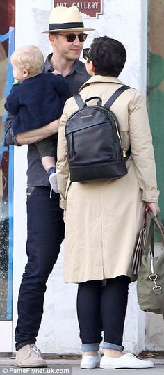 Fairytale romance: Josh sported a smile as wife Ginnifer stopped walking for a moment so the two could share a kiss