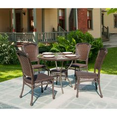 With its contemporary casual design, this 5-piece set is comfortable outdoor living to last the all weather conditions. Traditional hand woven wicker strapping with full size core all-weather resin; proven to withstand over 1000 hours in direct UV sunlight without fading or warping. #BackyardOasis #PatioDining