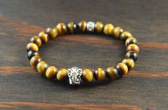 • Mens Tiger Eye Bracelet - Mens Beaded Bracelet - Mens Elephant Bracelet - Mens Yoga Bracelet - Mens Fashion Bracelet - Lotus and Lava Bracelet • • Tiger eye is used to focus the mind, which allows clearer thinking & insight. It helps you face & overcome difficult challenges & stick to your plans. Its said to bring good luck & protection to the wearer. • The main characteristics of the elephant are strength & steadfastness. Therefore they have become the symbol of physica...