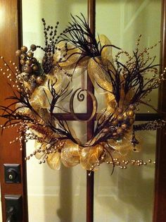 Wreath with the family initial hanging in the middle - beautiful!