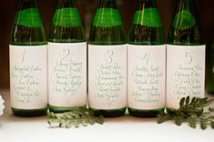 """wedding seating """"chart"""" in calligraphy. From our Emerald Botanical Beach styled shoot.  Styled by Simply by Tamara Nicole. Courtney Bowlden Photography. Calligraphy by Ephemera Press.  Venue: Cast Iron Studios"""