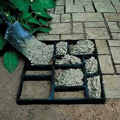 Cheap paving using a photo frame!