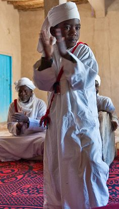 Africa   Sights and Sounds.  Les Pigeons du Sable, Sudanese dancers and musicians at Khemliya (or Khmlia), Morocco.